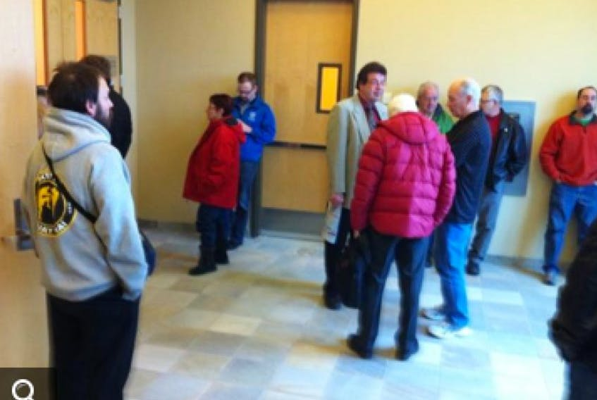 A small crowd gathers outside the courtroom on Nov. 14, before the day's proceedings begin.