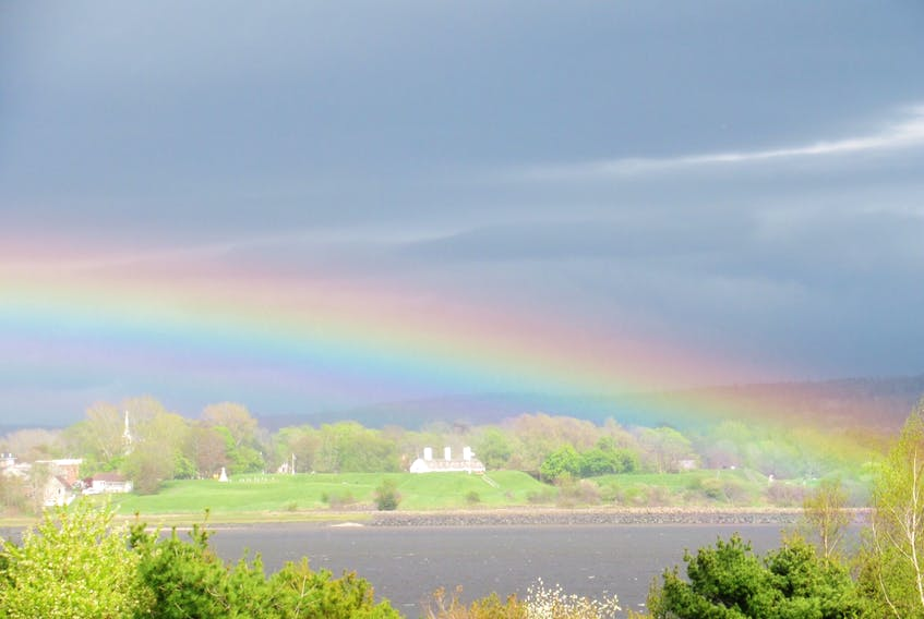 Brian Hay captured this rainbow over Fort Anne in Annapolis Royal, N.S, with his camera - but you can't catch a rainbow with your hand.