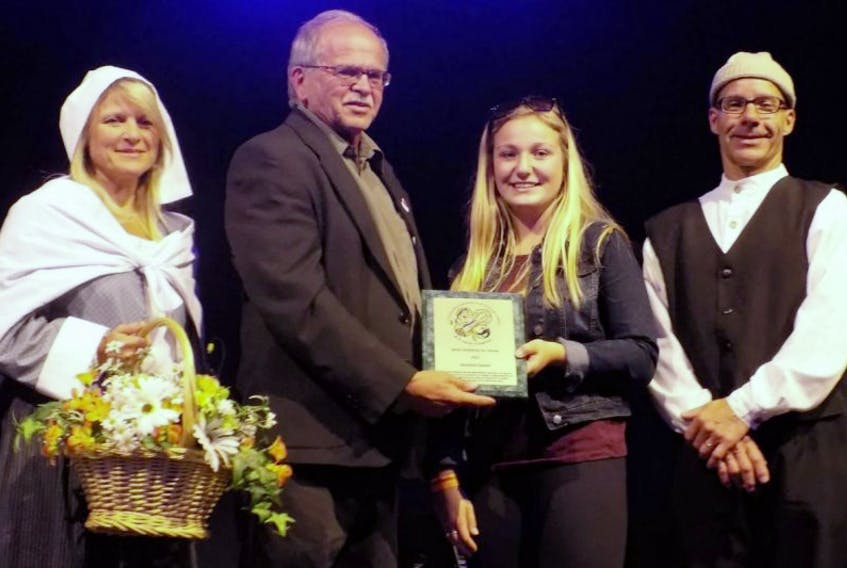 Taking part in the award ceremony were Odette Gallant as Evangeline, from left, Alcide Bernard, president of the Acadian Festival, Shelaine Gallant, Young Acadian of the Year and Dennis Gallant as Gabriel.