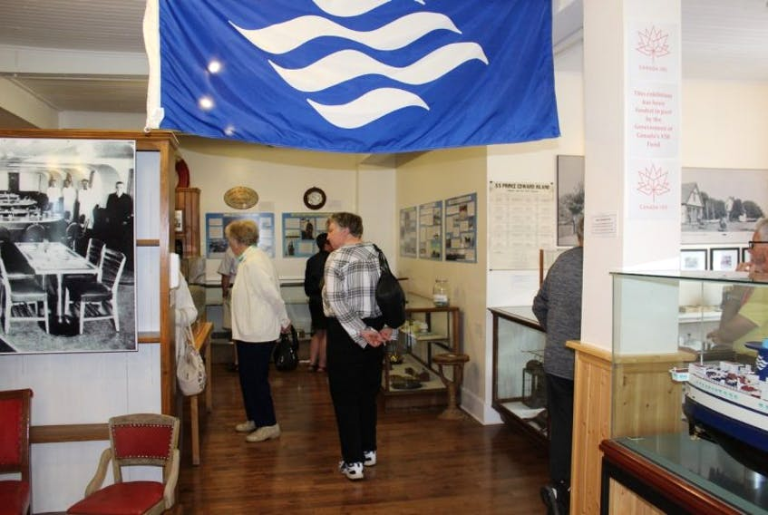 Some of the many people who visited the Bedeque Area Museum on its special open day on Sunday August 27, view the exhibit marking the centenary of the beginning of the ferry service from Borden to Cape Tormentine.