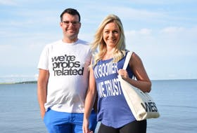 Luke Walker and Megan McDonald proudly show off some of the items available from their recently launched clothing line, East Coast AF Apparel.