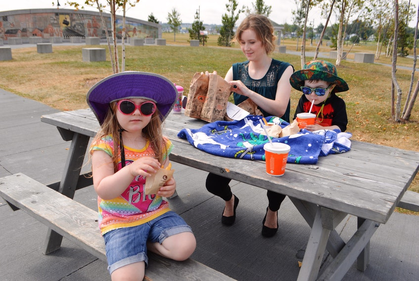 Julie Hicks of Westmount, enjoyed a picnic at the Open Hearth Park in Sydney with her children Rosie, 4, and Will 2, on Wednesday. Hicks said they visit the park a few times in the summer. The children were at the playground before taking a picnic break. Sharon Montgomery-Dupe • Cape Breton Post