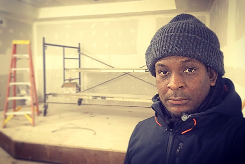 Derrick Pierre overseeing the construction of the new The Commune location