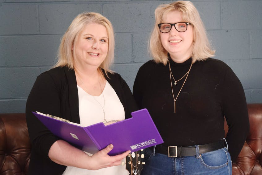 Shan MacLean and Karmen MacLean go over details for Pictou County's upcoming Relay for Life event. It will be held June 12 at The Commune.