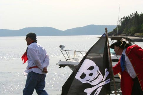 Pirate Peter Easton (played by Tom Hallett) forces a captured Frenchman (Clifford Powell) to walk the plank during a recreation of Easton's arrival in Happy Adventure, Bonavista Bay as part of the community's anniversary celebrations in August 2017.