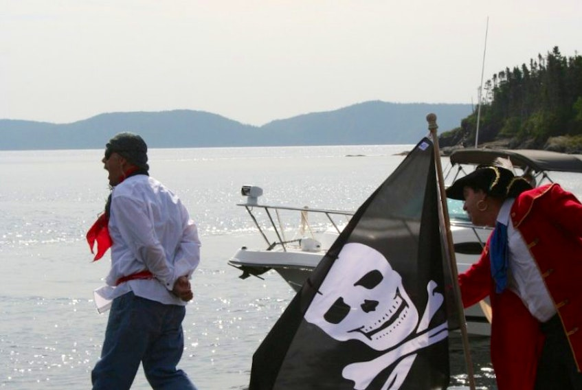 Pirate Peter Easton (played by Tom Hallett) forces a captured Frenchman (Clifford Powell) to walk the plank during a recreation of Easton's arrival in Happy Adventure, Bonavista Bay as part of the community's anniversary celebrations in August.