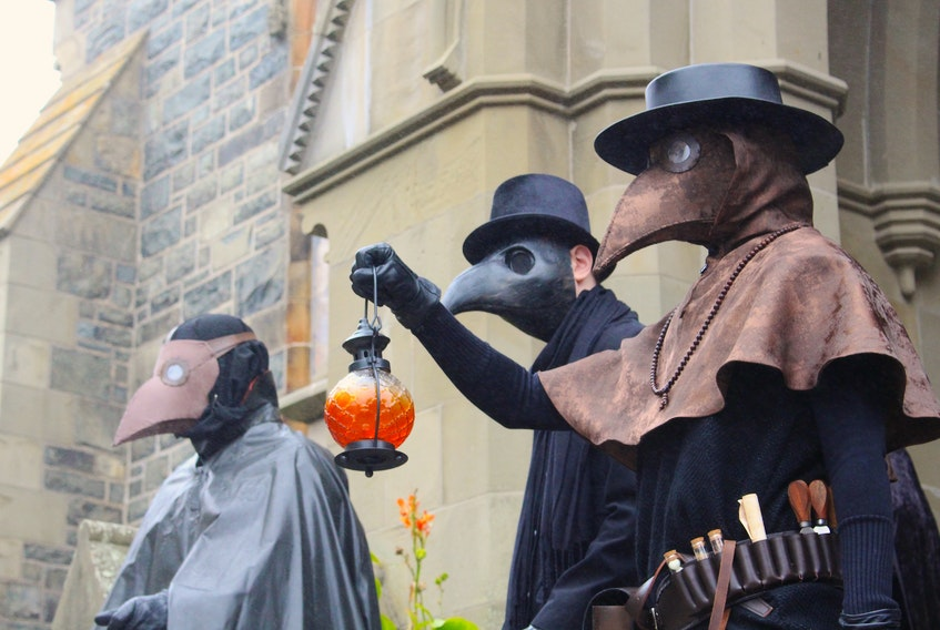 Originally designed in the early 1600s, these plague doctor outfits were an early form of personal protective equipment. It was then exaggerated when it was adopted by people attending the Venetian Carnival, cultural historian and author Ainsley Hawthorn said. — Andrew Waterman/The Telegram