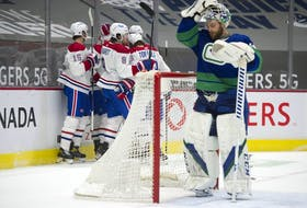 Vancouver Canucks goalie Braden Holtby reacts after a goal by the Montreal Canadiens in the second period of play at Rogers Arena Saturday.