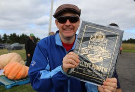 Peter Eyking proudly shows the plaque he won for ugliest pumpkin, for his entry that was in memory of his mother Jeanne Eyking. NICOLE SULLIVAN/CAPE BRETON POST