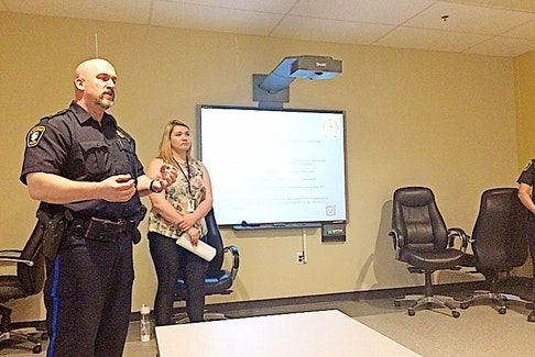 Deputy Chief Dwayne Pike discusses an Amherst Police Department audit of unfounded sexual assault complaints to community partners on Wednesday.
