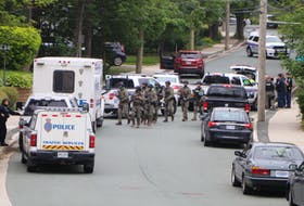 Members of the RNC's Tactics and Rescue Unit head back to their vehicle after being deployed near a property on Craigmillar Avenue in St. John's Sunday morning. Glen Whiffen/The Telegram