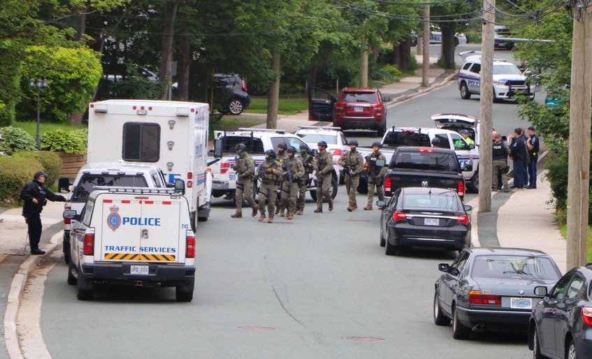 This July 5, 2020 file photo shows members of the RNC's Tactics and Rescue Unit heading back to their vehicle after being deployed near a property at the scene of a homicide on Craigmillar Avenue in St. John's. — File photo/Glen Whiffen/The Telegram