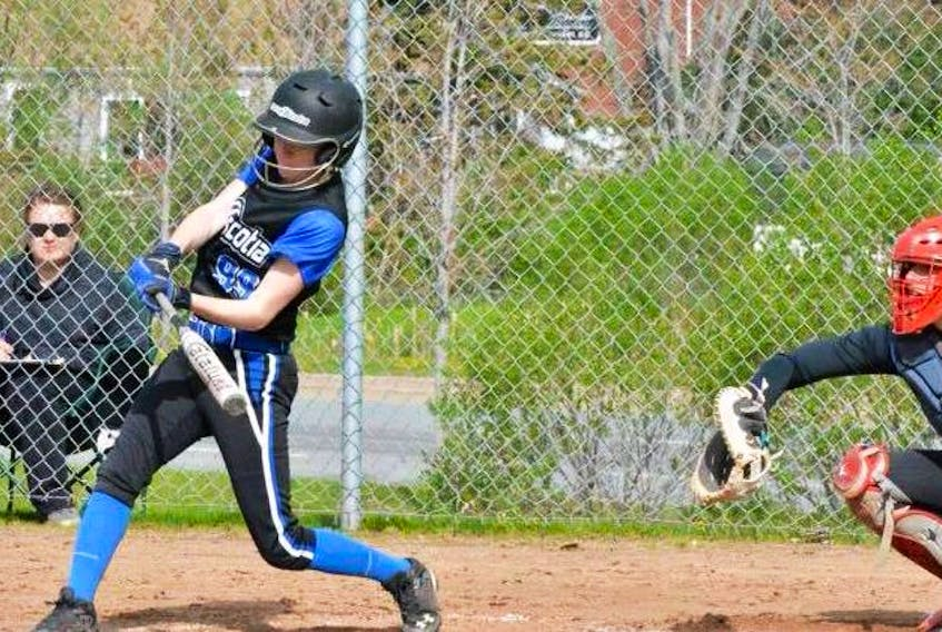 Brooke Hawley, left, makes contact with the ball as a member of Team Nova Scotia during a softball game in 2017. The Port Hood native began playing the sport in 2005 and has appeared in several national tournaments while also representing the province at the Canada Summer Games in 2013 and 2017. CONTRIBUTED • BROOKE HAWLEY