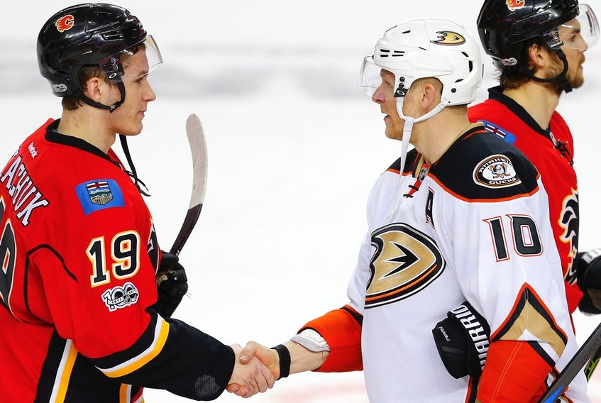 The Calgary Flames' Matthew Tkachuk and Corey Perry, then a member of the Anaheim Ducks, Shake after Game 4 of their 2017 Western Conference quarter-final series at the Saddledome. The Ducks won 3-1 to sweep the best-of-seven series. Al Charest/Postmedia