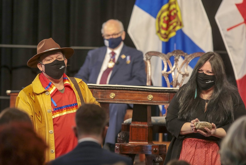 Elder Todd Labrador and Melissa Labrador perform a smudging ceremony during the swearing-in of Premier Iain Rankin and the cabinet on Tuesday. CONTRIBUTED