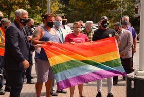 Pride Cape Breton kicked off their annual celebration Friday in Sydney with a flag raising at the Civic Centre. Attending the event were, from left, Cape Breton Regional Municipality Mayor Cecil Clarke, Dave Ward, co-chair for this year's celebration, Amy MacNeil, event co-chair and Darnell Kirton, who earlier this year organized a support march for Black Lives Matter. CAPE BRETON POST PHOTO