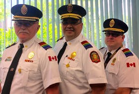 Cape Breton Regional Fire Service deputy chief Gilbert, from left, Chief Mike Seth and deputy chief Chris March wear their Pride-coloured epaulets to celebrate Pride month and the local LGBTQ community. CONTRIBUTED