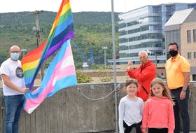 The normal speeches and crowds cheering on were absent in the anything but normal year of 2020 when the pride and trans flags were raised at St. John's City Hall Friday. Missing this year, as well, will be the several thousand-strong pride parade for the lesbian, gay, bisexual trangendered plus (LGBT+ community and their supporters, but virtual events and family and friends gathering in their bubbles are filling in. From left raising the flags are St. John's Pride finance co-chair Gorvin Greening, Mayor Danny Breen and Ward 3 Coun. Jamie Korab. In front are Sesily Howlett, 7, and Kendra Korab, 6. BARB SWEET/THE TELEGRAM