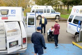 A patient is helped to get into one of the Pat and the Elephant vans that will take her to her new home on the Maypoint Road Sunday. The palliative care unit will remain at the old Prince Edward Home.