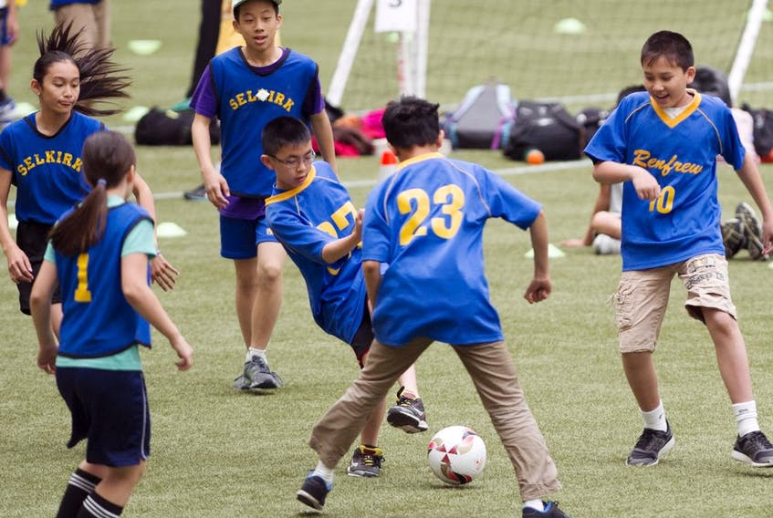 Kids playing soccer in  East Vancouver in 2014.