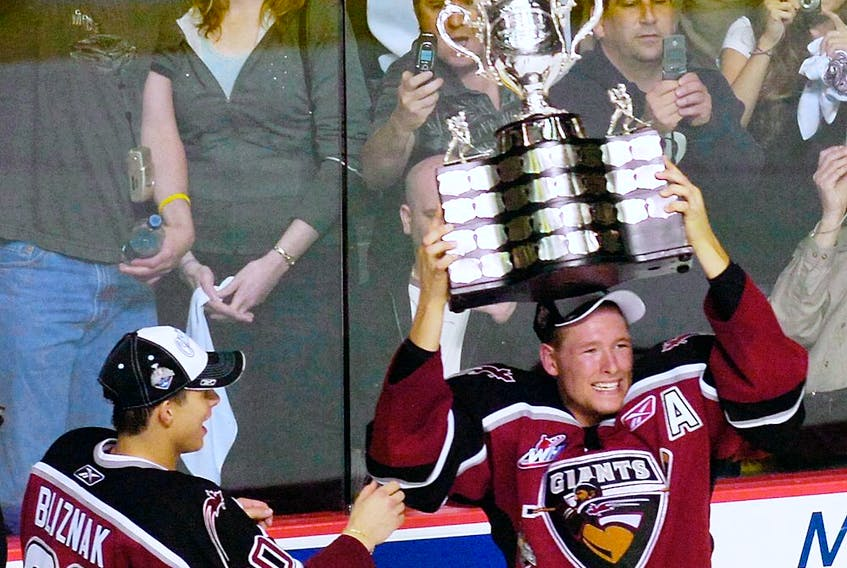Former Vancouver Giant J.D. Watt hoists the Memorial Cup after his WHL team beat the Medicine Hat Tigers 3-1 in the 2007 Memorial Cup Final at the PNE Coliseum in Vancouver.