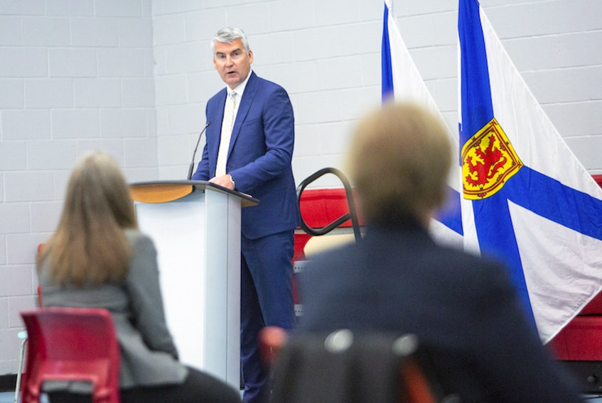 Nova Scotia Premier Stephen McNeil apologizes on behalf of the province for systemic racism in the justice system, including in policing and the courts, at a news conference in Halifax on Tuesday, Sept. 29, 2020.