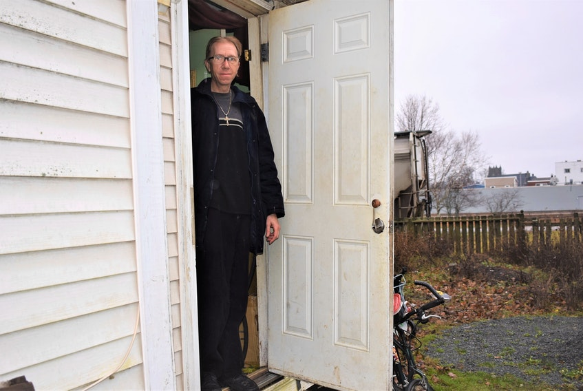 Thomas Richard at the entrance of his Brunswick Street apartment. He is scheduled to leave the building in the middle of the month and, as of Dec. 5, had no prospects for a new place to live.