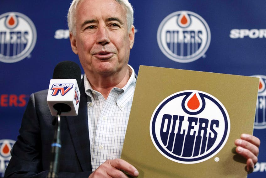 Oilers Entertainment Group CEO Bob Nicholson holds up a NHL draft card as he speaks about the Edmonton Oilers winning the draft lottery and selecting top prospect Connor McDavid during a press conference at Rexall Place in Edmonton on April 20, 2015.