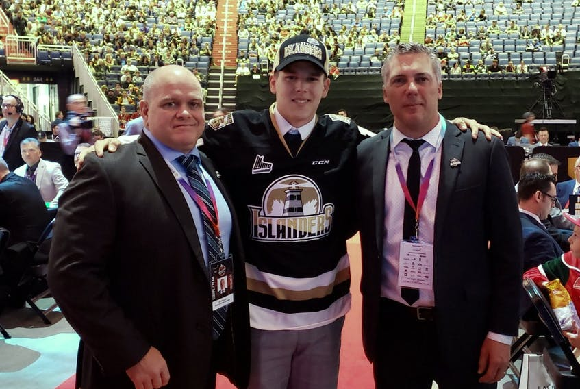 Centre Justin Gill was the Charlottetown Islanders' second pick of the 2019 Quebec Major Junior Hockey League draft in Quebec City. He was welcomed to the franchise by head coach and general manager Jim Hulton, right, and associate coach and assistant general manager Guy Girouard.
