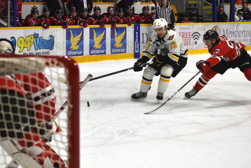 Cape Breton Eagles forward Félix Lafrance, middle, works his way to the net as he's pressured by Anthony Gagnon of the Quebec Remparts during Quebec Major Junior Hockey League action at Centre 200 in Sydney on March 4. The QMJHL is targeting an Oct. 1 start date for the 2020-21 season, depending on the COVID-19 situation. JEREMY FRASER/CAPE BRETON POST