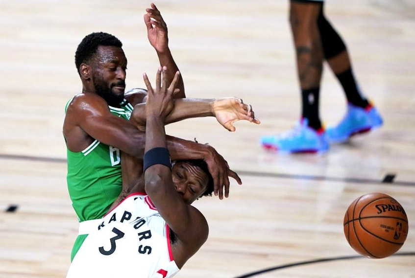 Boston Celtics' Kemba Walker, and Toronto Raptors' OG Anunoby compete for the ball last night in Lake Buena Vista, Fla.AP