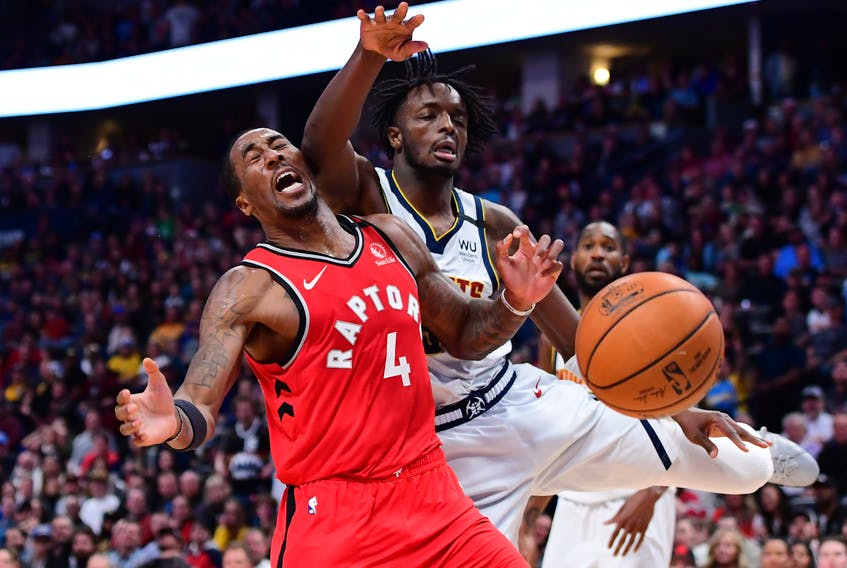 Denver Nuggets forward Jerami Grant (9) collides with Raptors forward Rondae Hollis-Jefferson during the second half at the Pepsi Center on Sunday night. (Ron Chenoy/USA TODAY Sports)