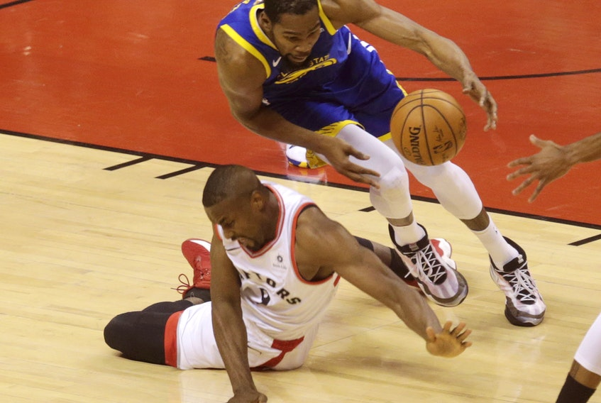 Kevin Durant hits the deck during Game 5 of the NBA Finals while chasing the ball with Serge Ibaka.