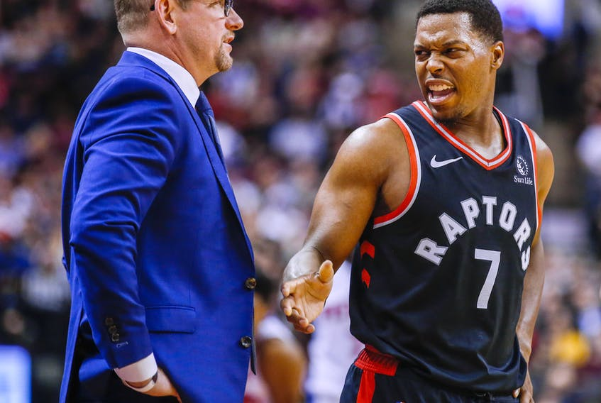Raptors head coach Nick Nurse (left) says Kyle Lowry and the Raptors are looking good in training in Florida.
