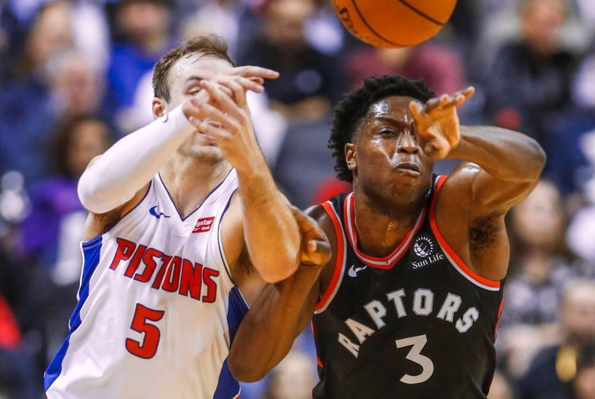 OG Anunoby of the Toronto Raptors and Luke Kennard, then of the Detroit Pistons, battle for the ball at Scotiabank Arena in Toronto on Oct. 30, 2019.