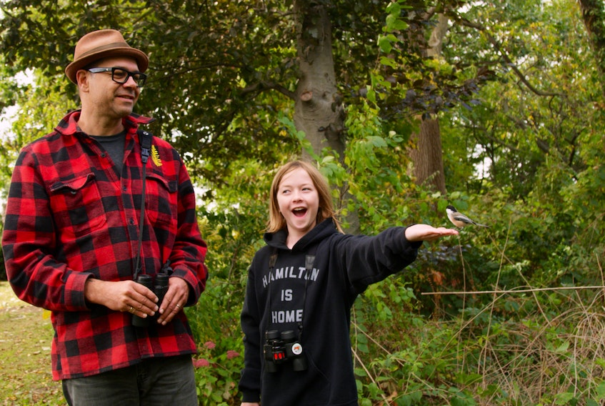 Hardcore birder Paul Riss and his daughter Georgia Wren commune with a curious chickadee in Michael Melski's new documentary The Rare Bird. The colourful look at the world of North American birding airs on CBC Docs POV on Saturday at 8 p.m. and on the free CBC Gem streaming service.
