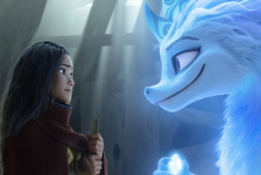Raya (voiced by Kelly Marie Tran) and Sisu (Awkwafina) in Raya and the Last Dragon.