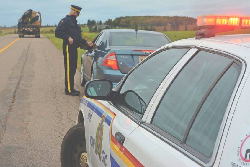 <p>Const. Jon Russell and his fellow RCMP are warning Islanders to slow down obey the traffic laws when passing officers pulled over to the side of the road. Colin MacLean/Journal Pioneer</p>