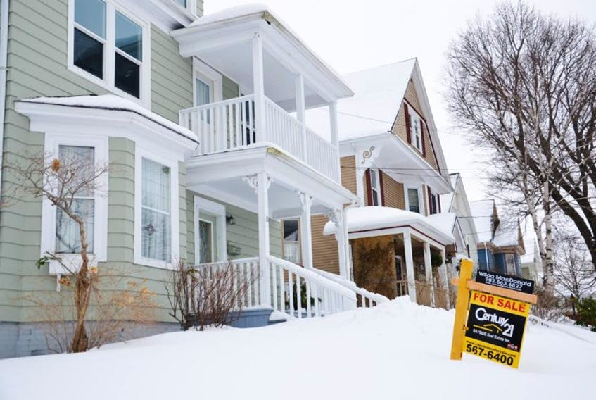 A for sale sign sits on the snow covered front yard of this home on Beacon Street in Sydney. Home sales across the island were strong last year and to start this year in Cape Breton. That trend is expected to continue right across the province for the rest of 2015.<br /><br /><br />