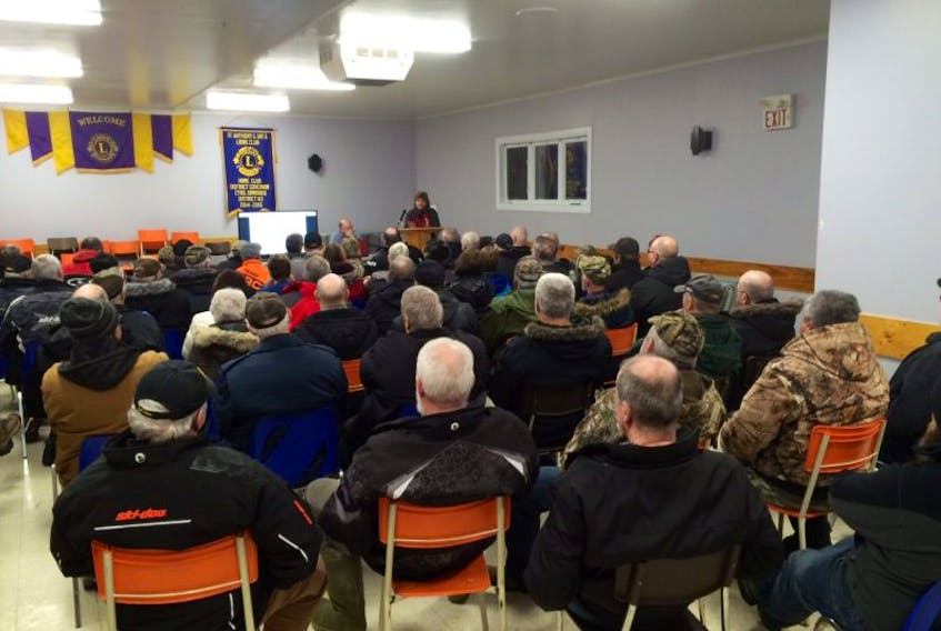 MP Gudie Hutchings talks to the crowd gathered at the Lions Club in St. Anthony about the recreational cod fishery.