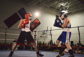Cruz Sylliboy, left, of Red Tribe Boxing Club is shown fighting Braydon Collins of North Sydney during the Red Tribe Boxing Club's first-ever Saturday Fight Night at the Eskasoni Elementary/Middle School in Eskasoni on Saturday. Collins won the fight by decision.