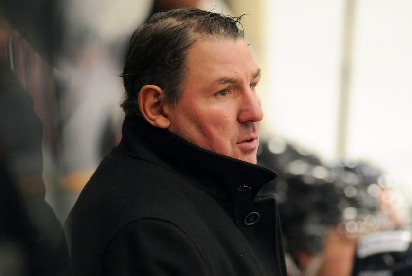 Darren Langdon, who has been named the West Coast Senior Hockey League's Coach of the Year, and his regular season champion Deer Lake Red Wings are undefeated the league's playoffs.