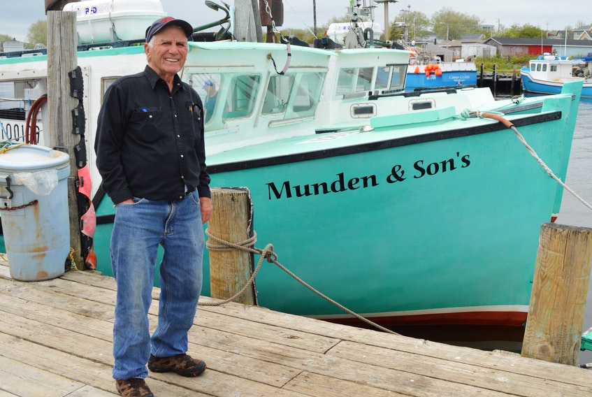 Longtime fisherman Jim Munden stands on the Glace Bay wharf in front of a couple of the fishing boats that supply fresh lobsters to the dock-side Munden's Lobster Pound on a daily basis. The soon-to-be 89-year-old has been fishing since he was nine-years-old. DAVID JALA/CAPE BRETON POST
