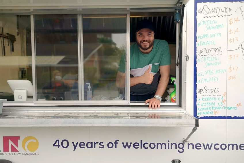 Amr Alagouza, originally from Egypt, is the project lead for Global Eats food truck, a social enterprise created by the Association for New Canadians. – Andrew Waterman/The Telegram
