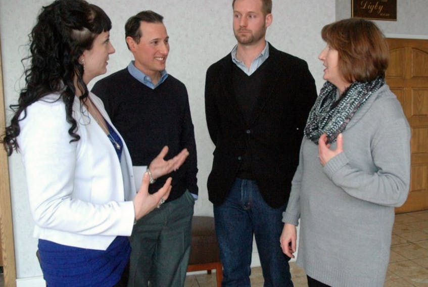 <p>Chatting after a Jan. 20 luncheon at the Rodd Grand Hotel (from left): Sarah Ryan of Brilliant Labs, Michael Carbonell of YACRO Social Enterprises, Dustin DuPrat of RennDuPrat Design and Loretta Davis, representing the Yarmouth and Area Chamber of Commerce. The luncheon was part of the chamber's Reinventing Rural series.<br />ERIC BOURQUE PHOTO</p>