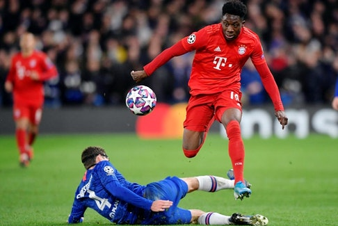 Bayern Munich's Alphonso Davies in action with Chelsea's Andreas Christensen in Champions League Round of 16 First Leg match at Stamford Bridge, London on February 25, 2020.