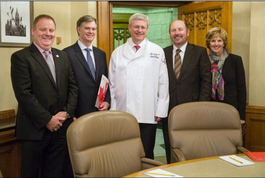 <span>Restaurants Canada presented Prime Minister Harper with an official chef jacket during a recent meeting. From left: Restaurants Canada chair Liam Dolan, Restaurants Canada past president Garth Whyte, Prime Minister Harper, Restaurants Canada director Gerard Curran and Restaurants Canada's Joyce Reynolds.</span>