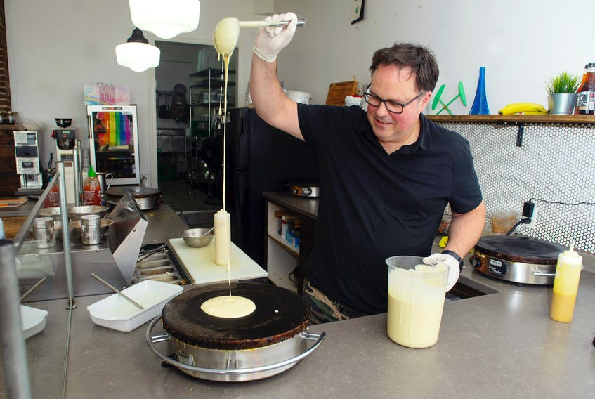 Neil Cook makes a crepe at his Portland Street Creperie restaurant in this file photo from June. Ryan Taplin - The Chronicle Herald