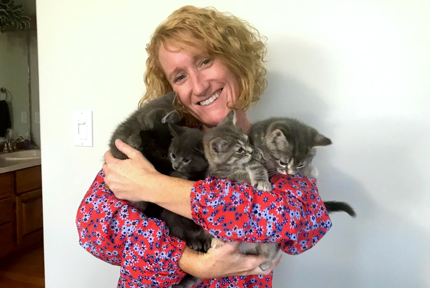Bobbi-Jo Reardon of Rice Point says being a foster family for the P.E.I. Humane Society is a lot of work, but she wouldn't trade these cuddles for the world.
