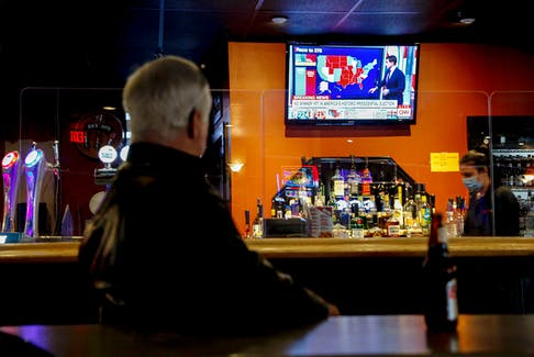 A man watches the television coverage of the U.S. election, at Dooley's in Halifax Wednesday, Nov. 4. Tim Krochak/SaltWire Network